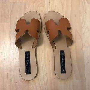 Brown leather slide sandals. Steve Madden